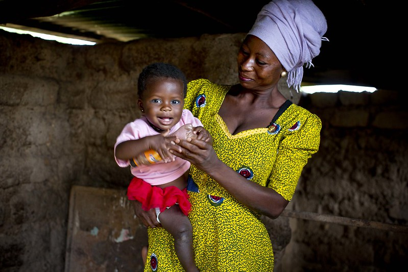 Here, Rahama, 30, plays with her 9-month-old daughter, Maradiatu, inside their home.
