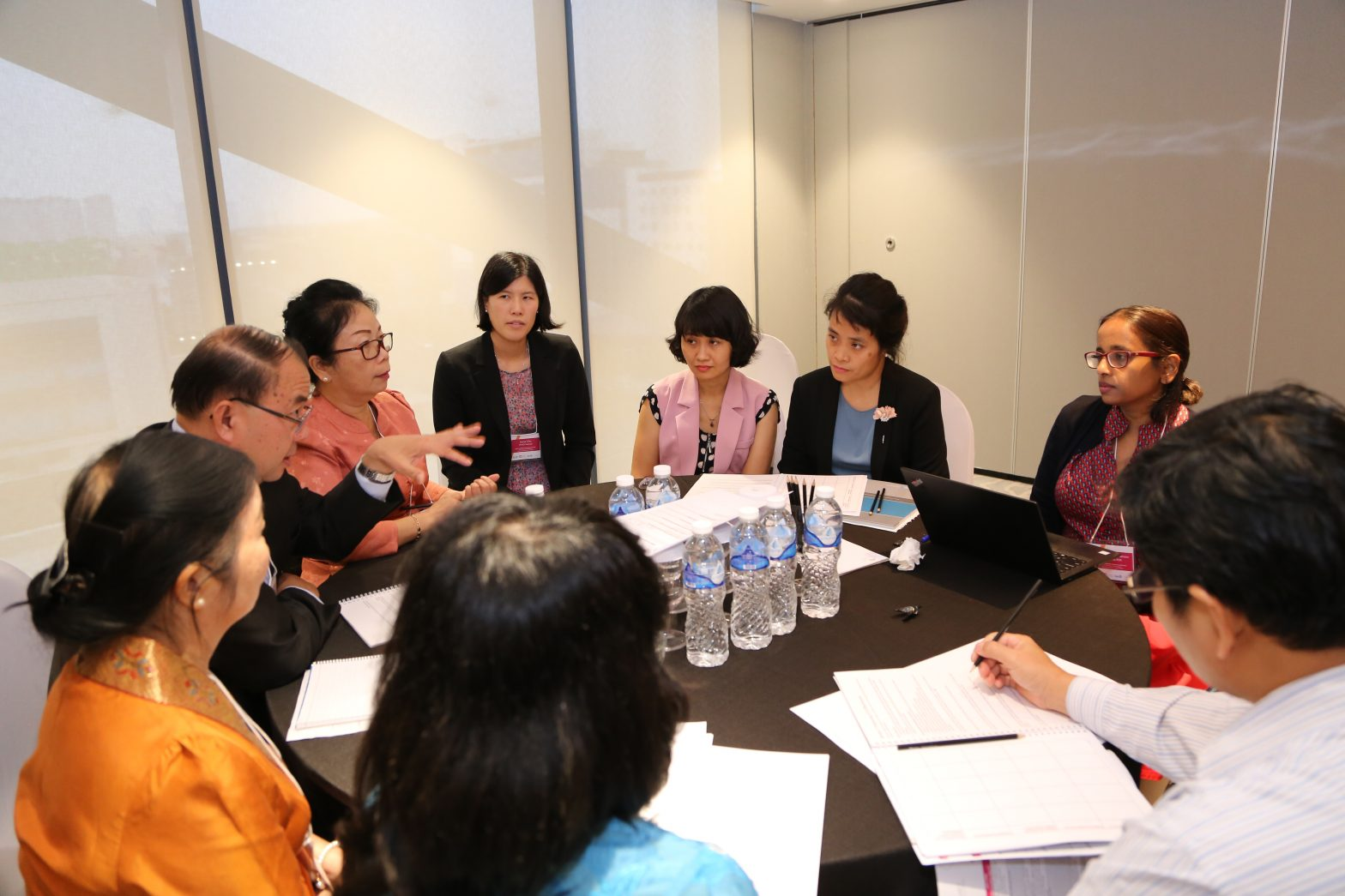 Health policy and research professionals from the Asia region discuss process improvements at a roundtable