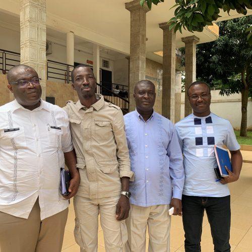 Four men standing outside